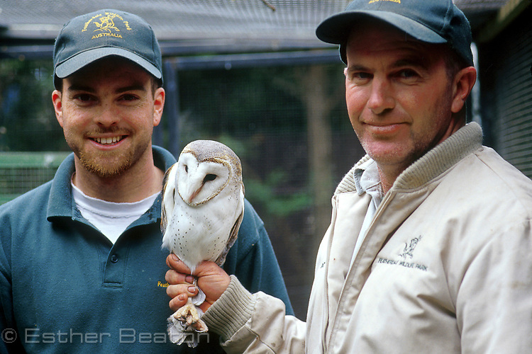 Rick Webb holding Barn Owl, and assistant Ben, Featherdale Wildlife Park, Doonside, Sydney, New South Wales