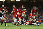 Wales replacement scrum half Rhodri Williams bursts through the Scottish defence.<br /> RBS 6 Nations 2014<br /> Wales v Scotland<br /> Millennium Stadium<br /> <br /> 15.03.14<br /> <br /> &copy;Steve Pope-SPORTINGWALES