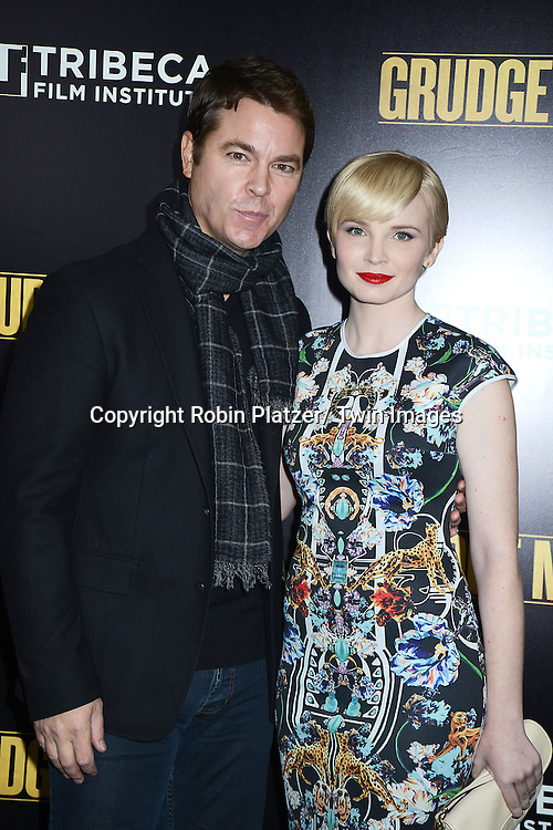 "Mark Johnson and Elizabeth Olin attends the World Premiere of ""Grudge Match"" at the Ziegfeld Theatre in New Yok City on December 16, 2013."