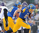 BROOKINGS, SD - NOVEMBER 15: Zach Zenner #31 from South Dakota State University breaks though the defensive line of Western Illinois for a touchdown in the second quarter Saturday afternoon at Coughlin Alumni Stadium in Brookings. (Photo by Dave Eggen/Inertia)