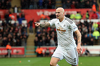 SWANSEA, WALES - FEBRUARY 21: Jonjo Shelvey of Swansea celebrates his goal, making the score 2-1 to his team during the Barclays Premier League match between Swansea City and Manchester United at Liberty Stadium on February 21, 2015 in Swansea, Wales.