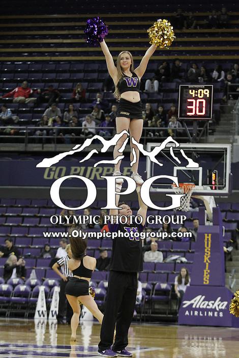 SEATTLE, WA - DECEMBER 18: Washington cheerleader Julia Bautel entertained fans during a timeout against Savannah State.  Washington won 87-36 over Savannah State at Alaska Airlines Arena in Seattle, WA.