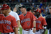 Batavia Muckdogs hitting coach Jesus Merchan (10), pitching coach Jason Erickson (51) and defensive coach Ronnie Richardson (2) celebrate a walk off win after a game against the West Virginia Black Bears on July 3, 2018 at Dwyer Stadium in Batavia, New York.  Batavia defeated West Virginia 5-4.  (Mike Janes/Four Seam Images)