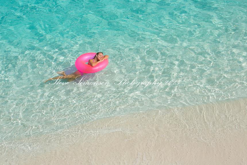 Cassandra Bitterwolf in a pink swim ring<br /> Trunk Bay<br /> Virgin Islands National Park<br /> St. John<br /> US Virgin Islands