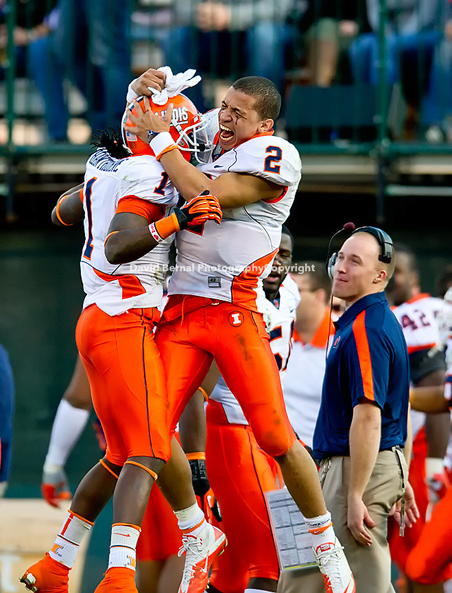 SAN FRANCISCO, CA - December 31, 2011: Illinois players cornerback Terry Hawthorne (1) and quarterback Nathan Scheelhaase (2) celebrate during the Kraft Bowl against UCLA at AT&T Park in San Francisco, California. Final score Illinois wins 20-14.