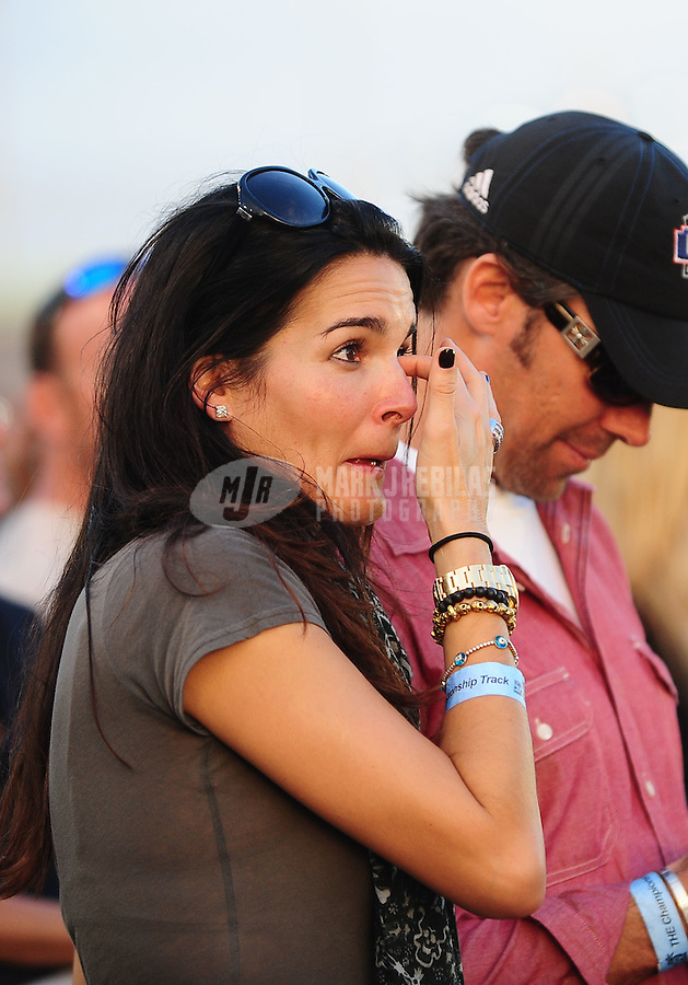 Nov. 21, 2010; Homestead, FL, USA; Television actress Angie Harmon cries as she watches NASCAR Sprint Cup Series driver Jimmie Johnson (not pictured) celebrating his championship following the Ford 400 at Homestead Miami Speedway. Mandatory Credit: Mark J. Rebilas-