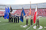 The Color Guard presents the flags during the National Anthem prior to the Wisconsin Badgers NCAA college football game against the Austin Peay Governors on September 25, 2010 at Camp Randall Stadium in Madison, Wisconsin. The Badgers beat the Governors 70-3. (Photo by David Stluka)