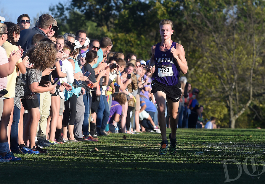 NWA Democrat-Gazette/MICHAEL WOODS &bull; @NWAMICHAELW<br /> Camren Fischer from Fayetteville High School crosses the finish line to take first place Tuesday, November 1, 2016 during the 7A-West Conference cross country meet at Rogers High School. More photos at nwadg.com/photos