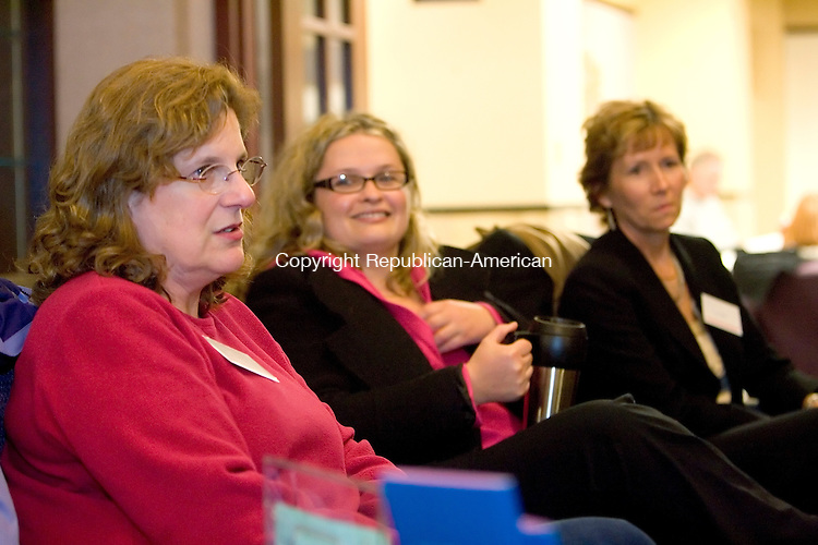 WATERBURY, CT- 27 JANUARY 2009 --012709JS04-Beth Heiss, left, gives advice to a new person in the group as Liz Newman, center and Laura McKail, right, look on during a gatering of the Brave at Heart breast cancer support group recently at the Harold Leever Regional Cancer Center in Waterbury. <br /> Jim Shannon / Republican-American