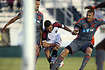 16 April 2016: Ottawa's Idan Vered (ISR) (23) is defended by Carolina's Connor Tobin (13) and Paul Black (ENG) (left). The Carolina RailHawks hosted Ottawa Fury FC at WakeMed Stadium in Cary, North Carolina in a 2016 North American Soccer League Spring Season game. Carolina won the match 1-0.