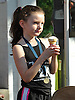 Makayla Connolly, 8, of Northport enjoys an ice cream cone as she watches the community's annual Cow Harbor 10-kilometer run near the finish line on Saturday, September 19, 2015.<br /> <br /> James Escher