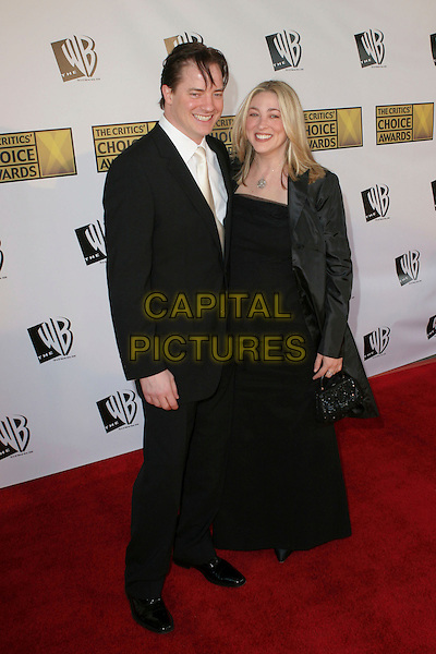 BRENDAN FRASER & AFTON SMITH.11th Annual Critics' Choice Awards - Arrivals held at Santa Monica Civic Auditorium, Santa Monica, California..January 9th, 2006.Photo: Zach Lipp/AdMedia/Capital Pictures.Ref: ZL/ADM.full length married husband wife black suit dress.www.capitalpictures.com.sales@capitalpictures.com.© Capital Pictures.