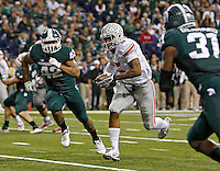Ohio State Buckeyes quarterback Braxton Miller (5) scores on his second rushing touchdown in the 3rd quarter against the Michigan State Spartans defense during the Big 10 Championship game at Lucas Oil Stadium in Indianapolis, Ind on December 7, 2013.  (Dispatch photo by Kyle Robertson)