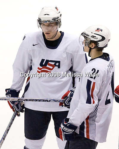 Ian Cole (USA 28) and Bill Sweatt (USA 21) line up on the blue line while Canada celebrates. Team Canada defeated Team USA 4-1 on Friday, January 4, 2008, during the World Junior Championship at CEZ Arena in Pardubice, Czech Republic.  The result put Team Canada into the gold medal game and Team USA into the bronze medal game.