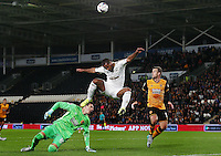 Wayne Routledge of Swansea City and Hull City goalkeeper Eldin Jakupovic during the Capital One Cup match between Hull City and Swansea City played at the Kingston Communications Stadium, Hull