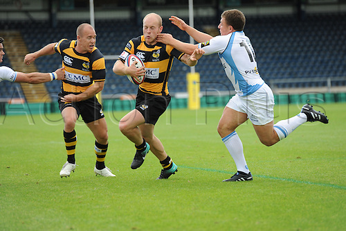 28.08.2010 Joe Simpson the London Wasps and England scrum half is tackled by Duncan Weir fly half of Glasgow Warriors during the Rugby Union match from Adams Park Wycombe Buckinghamshire. London Wasps take on Glasgow Warriors in a pre season friendly.