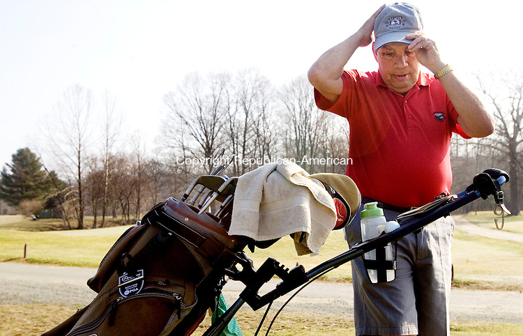 SOUTHBURY, CT. 19 March 2012-031912SV06-Jerry Cloutier of Southbury puts on his hat to shade the sun, as he gets ready to tee off, at the Pomperaug Golf Club in Southbury Monday. Abbot was enjoying the warm weather by golfing with friends..Steven Valenti Republican-American