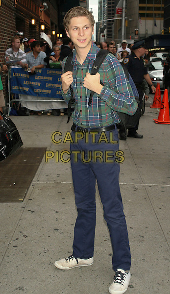 """MICHAEL CERA.Arriving to the Taping of the """"Late Show with David Letterman"""".at the Ed Sullivan Theater, New York, NY, USA, Sept 29th 2008..full length green and blue plaid shirt trainers backpack trousers tartan .CAP/LNC/TOM.©LNC/Capital Pictures"""
