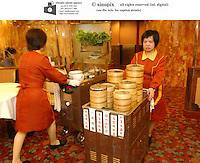 Dim sum waitresses and trolleys at Chiu chow Garden in Hong Kong.