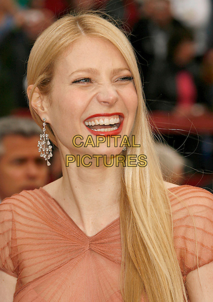 GWYNETH PALTROW.The 79th Annual Academy Awards - Arrivals held at the Kodak Theatre, Hollywood, California, USA,.February 25th, 2007..oscars red carpet portrait headshot orange peach Zac Posen pleated dress gown red lipstick smiling laughing funny.CAP/ADM/RE.©Russ Elliot/AdMedia/Capital Pictures...