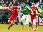 2nd February 2019, Easter Road, Edinburgh, Scotland; Ladbrokes Premiership football, Hibernian versus Aberdeen; Andrew Considine of Aberdeen  holds back Florian Kamberi of Hibernian
