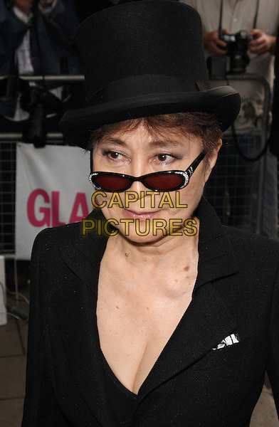 YOKO ONO .Glamour Women Of The Year Awards - Outside Arrivals, Berkeley Square Gardens, London, England, UK, .June 8th 2010. .portrait headshot black hat glasses jacket .CAP/ROS.©Steve Ross/Capital Pictures.