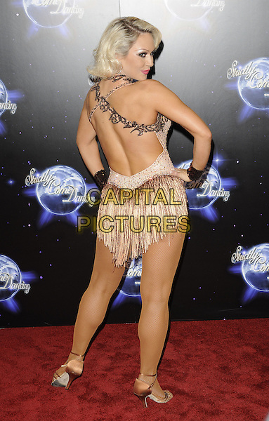KRISTINA RIHANOFF .At the Strictly Come Dancing Launch Show TV recording, London, England, UK, September 8th 2010..full length  halterneck top costume dress  beige sparkly strappy gold sandals hand on hip back rear behind backless  tassels .CAP/CAN.©Can Nguyen/Capital Pictures.