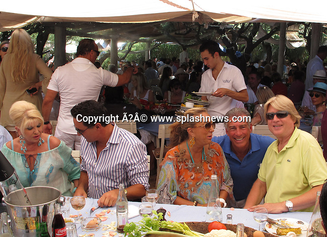 Celebrities at Club 55 Restaurant.<br /><br />Pictured: Ivana Trump, Denise Rich,  Niels H. Lauersen and Steve Varsano<br />Ref: SPL421604  290712  <br />Picture by: CelebrityVibe / Splash News<br /><br />Splash News and Pictures<br />Los Angeles:310-821-2666<br />New York:212-619-2666<br />London:870-934-2666<br />photodesk@splashnews.com