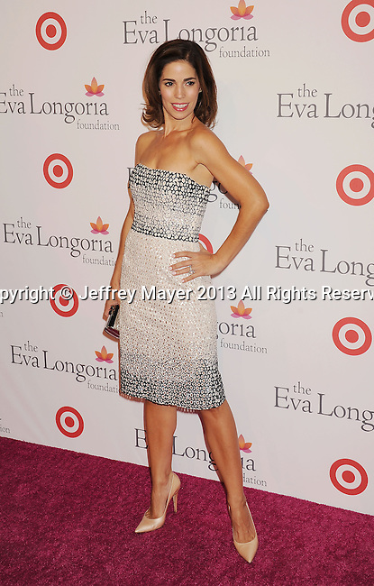 HOLLYWOOD, CA- SEPTEMBER 28: Actress Ana Ortiz arrives at the Eva Longoria Foundation Dinner at Beso restaurant on September 28, 2013 in Hollywood, California.