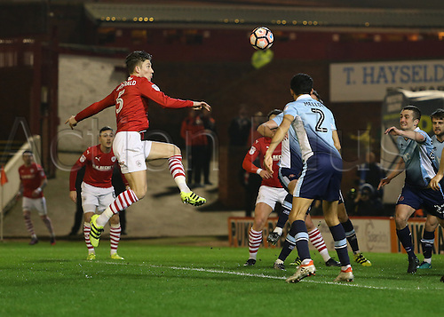 17th January 2017, Oakwell, Barnsley, South Yorkshire, England; FA Cup 3rd round replay, Barnsley versus Blackpool; Barnsley's Angus MacDonald attempts a high shot