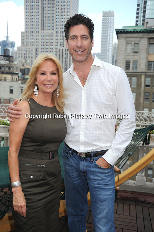 Kathie Lee Gifford, in Calvin Klein dress, and Eduardo Xol at the Childhelp and Hayneedle.com event at the Midtown LOft and Terrace in New York City on July 21, 2010.  July 22 is National Hammocks Day.