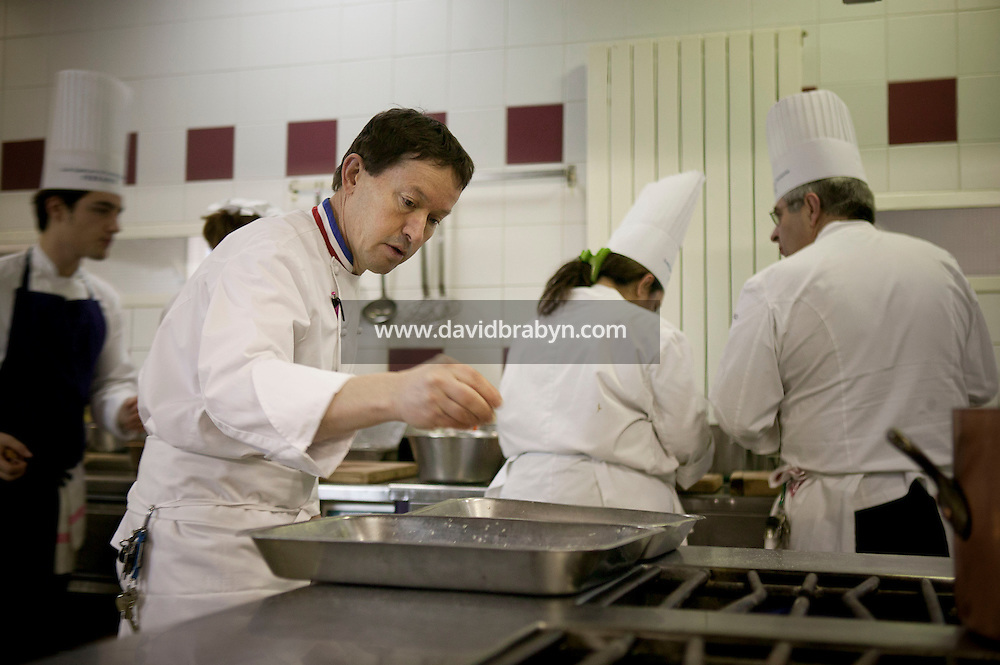 Chef Eric Robert (foreground) and students cook during a class at the Ecole Superieure de Cuisine Francaise Gregoire Ferrandi cooking school in Paris, France, 18 December 2007.