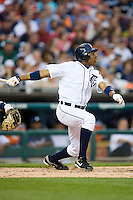 Curtis Granderson of the Detroit Tigers follows through on his swing versus the New York Yankees at Comerica Park April 27, 2009 in Detroit, Michigan.  Photo by Brian Westerholt / Four Seam Images