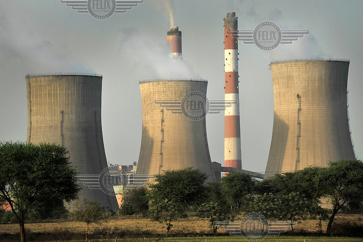 Smoke rises from the cooling towers of the Guru Hargobind Thermal Power Plant. Some of the output of ash from the coal burnt in the plant escapes into the air and has been speculatively linked to health problems in the area.