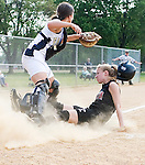 The Gazette Elizabeth Seton High School's Lindsey Baird slides home but is called out as Good Councel's catcher Karah Kuczarski tags her during the WCAC softball quarterfinal game played in Hyattsville on Tuesday afternoon. Seton won the game 7-3.