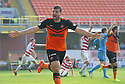 Dundee Utd's Nadir Ciftci starts to celebrate after he put the ball into the net but his celebration is cut short as he receives a second yellow and is sent off after using his hand.