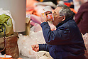 Saitama, Japan - A photo made available on March 22, 2011 shows an evacuee finishing up his instant ramen noodles at Saitama Super Arena, a temporary shelter in Saitama, north of Tokyo. Thousands of residents from Fukushima evacuated their town as high levels of radiation continued to be a high risk from the quake-hit nuclear plant. (Photo by Christopher Jue/Nippon News/AFLO)
