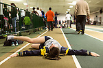 January 25, 2014. Winston Salem, North Carolina.<br /> Kayla Montgomery stretches in preparation  to run in the 1600m at the 2014 David Oliver Classic. <br />  3 and a half years ago, during an examination after sustaining tailbone and head injuries from a fall during a soccer game, Kayla Montgomery, now 18, was diagnosed with multiple sclerosis. Montgomery, then a decent runner, refused to be limited by her diagnosis, and after years of training has become one of the best high school runners in the country.