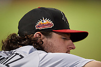 A close-up look at the new Arizona Fall League logo on the hat of Scottsdale Scorpions pitcher Garrison Schwartz (7) during an Arizona Fall League game against the Mesa Solar Sox on September 18, 2019 at Sloan Park in Mesa, Arizona. Scottsdale defeated Mesa 5-4. (Zachary Lucy/Four Seam Images)