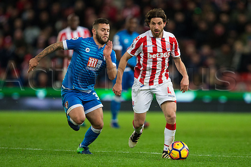 19.11.2016. Bet365 Stadium, Stoke, England. Premier League Football. Stoke City versus AFC Bournemouth. Bournemouth midfielder Jack Wilshere and Stoke City midfielder Joe Allen chase after a loose ball.