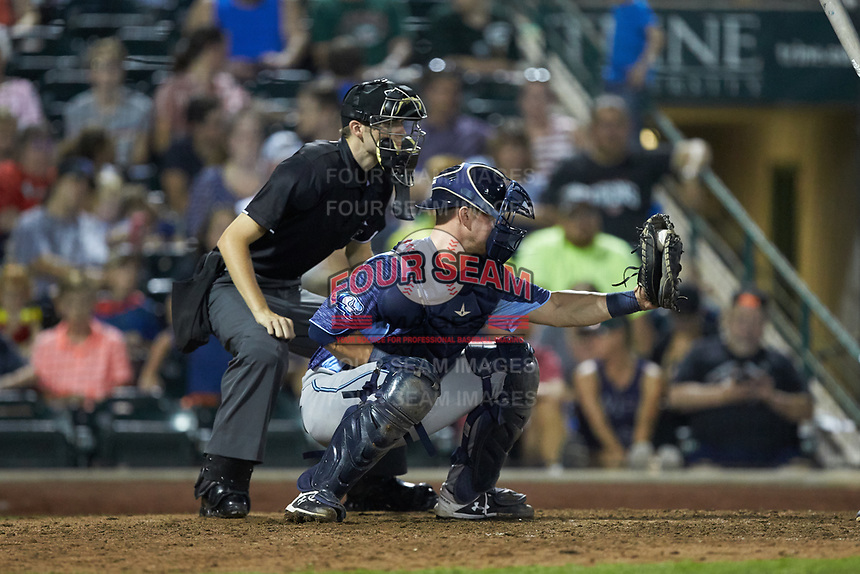 West Michigan Whitecaps catcher Cooper Johnson (37) frames a pitch as home plate umpire Nathan Diederich looks on during the game against the Fort Wayne TinCaps at Parkview Field on August 5, 2019 in Fort Wayne, Indiana. The TinCaps defeated the Whitecaps 9-3. (Brian Westerholt/Four Seam Images)