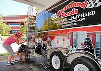 NWA Media/DAVID GOTTSCHALK - 9/22/14 - Sheila Killion, left, and Keylan (cq) Conley, both with Heartland Honda of Springdale, construct display racks at the Bikes, Blues & BBQ venue in the Walton Arts Center parking lot on Dickson Street and West Street Monday September 22, 2014 in Fayetteville. This is the 15th year for the motorcycle rally that runs from September 24 through September 27 with music, vendors, activities and events taking place throughout Fayetteville and Northwest Arkansas.