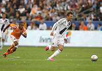 CARSON, CA - DECEMBER 01, 2012:   David Beckham (23) of the Los Angeles Galaxy runs away from Ricardo Clark (13) of the Houston Dynamo during the 2012 MLS Cup at the Home Depot Center, in Carson, California on December 01, 2012. The Galaxy won 3-1.