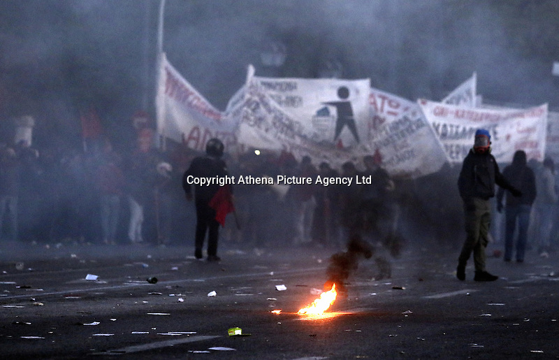 Pictured: Rioters with flags and banners Sunday 09 May 2016<br />Re: Riots break out between protesters and police in Syntagma Square, while MPs in the Greek Parliament vote for new tax, pension and welfare reforms in Athens, Greece