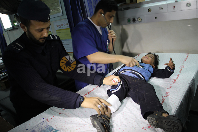A wounded Palestinian boy is wheeled into a hospital in Gaza City, after an Israeli air strike March 12, 2012. Israeli air strikes killed two Palestinian militants and a civilian in the Gaza Strip on Monday in a fourth day of cross-border hostilities, medical sources said. Photo by Mohammed Asad