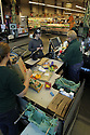 Cashier checking out a customer at the register