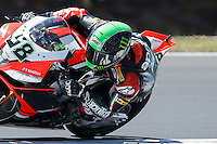 Eugene Laverty (IRL) riding the Aprilia RSV4 1000 Factory (58) of the Aprilia Racing Team rounds turn 11 during a practise session on day two of round one of the 2013 FIM World Superbike Championship at Phillip Island, Australia.
