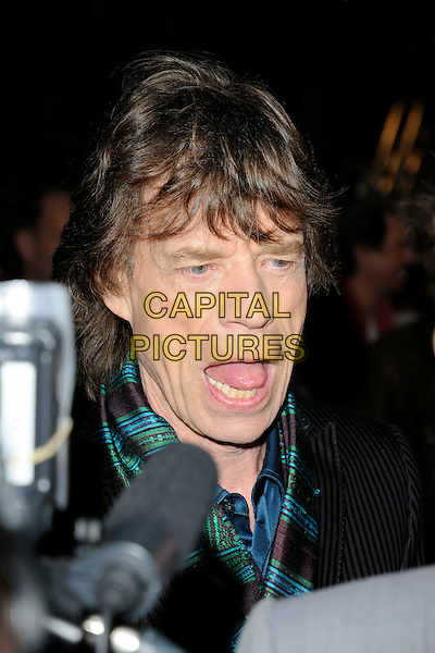 """THE ROLLING STONES - MICK JAGGER.UK premiere of """"Shine A Light"""" Odeon Cinema, Leicester Square, London, England..April 2nd, 2008.headshot portrait mouth open tongue funny face .CAP/CAN.©Can Nguyen/Capital Pictures."""