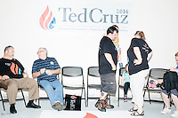 People talk with one another after hearing Texas senator and Republican presidential candidate Ted Cruz speak to a crowd at the kick-off event at his New Hampshire campaign headquarters in Manchester, New Hampshire.
