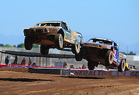 Apr 16, 2011; Surprise, AZ USA; LOORRS driver Johnny Greaves (16) leads Ricky Johnson (48) during round 3 at Speedworld Off Road Park. Mandatory Credit: Mark J. Rebilas-.